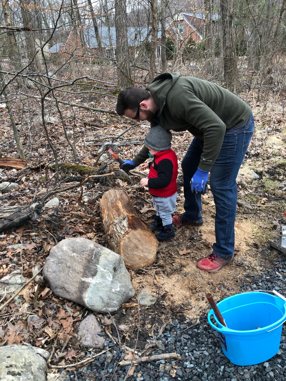 dad and baby chopping wood